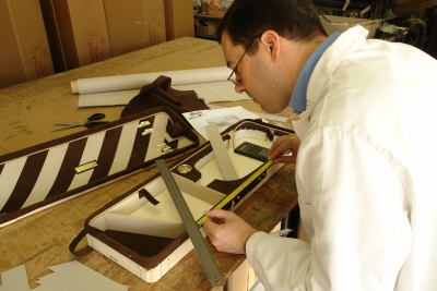Dimitri Musafia personally creating the distinctive interior of Opus VII. Opus cases are special, individually crafted cases in which Mr. Musafia personally takes part in the construction, not just the design.